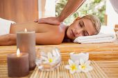 foto of day care center  - Attractive young woman receiving back massage at spa center - JPG