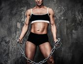 picture of transexual  - Muscular bodybuilder woman holding chains - JPG
