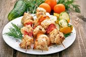 stock photo of kebab  - Chicken shish kebab and fresh vegetables on wooden table - JPG