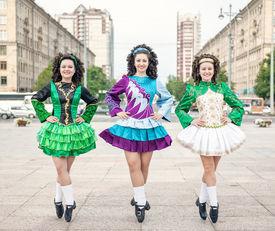 image of irish  - Three women in irish dance dresses and wig posing outdoor - JPG