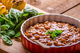 stock photo of jalapeno  - Spicy cowboy beans with chilli jalapeno scallions and bacon