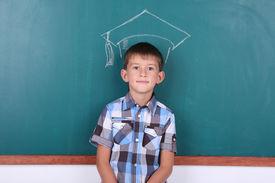 pic of schoolboys  - Schoolboy at blackboard in classroom - JPG