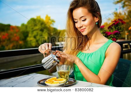 Young Woman Making Green Tea Outdoors