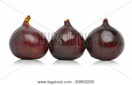 Three Fresh Figs Isolated On The White