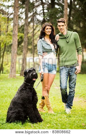 Handsome Couple With Dog