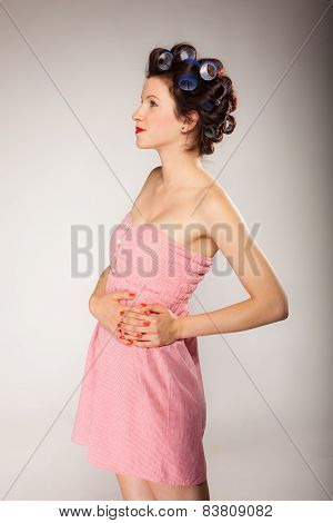 Girl In Hair Curlers On Gray