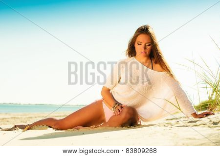 Long Haired Girl On Sandy Beach Blue Sky