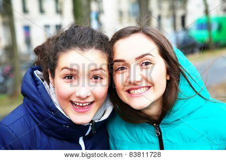 Happy Beautiful Student Girls On The Street