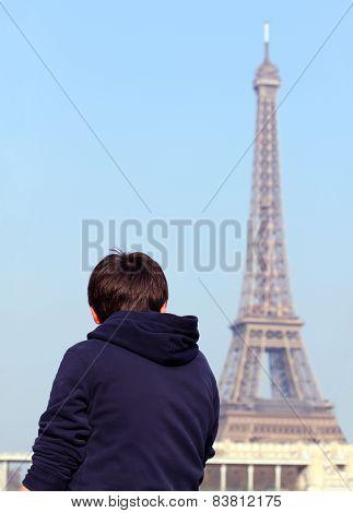 Boy Looking At Eiffel Tower In Paris, France