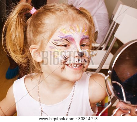 little girl with faceart on birthday party in process