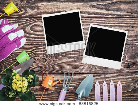 Gardening Tools And Photo Frame On A Wooden Table