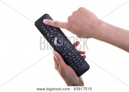 Female Hand Holding A Remote Controller On White Background