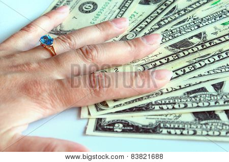 woman's hand purchasing the ring with topaz
