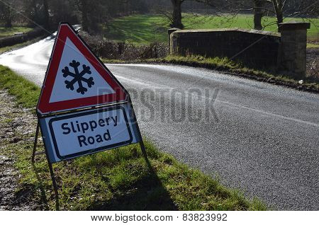 Slippery road traffic sign.