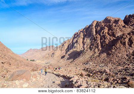 Tourists At The Foot Of Mount Moses Go To The Monastery Of St. Catherine