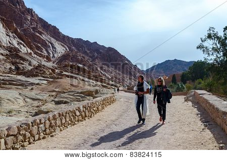 Tourists Go Along The Road From The Monastery Of St. Catherine To The Car Park