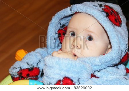 Little Baby In Dressing Gown With Amazed Sight