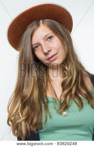 Blonde teenage girl wearing brown hat