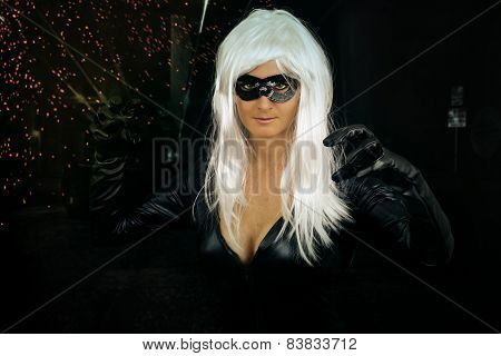 woman with white hair dressed in superhero