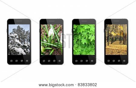 Four Smart-phones With Colored Images Of Seasons