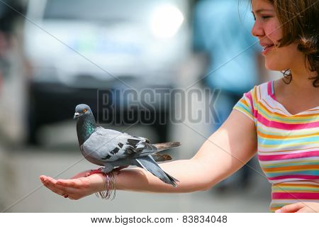 Girl Holding Pigeon