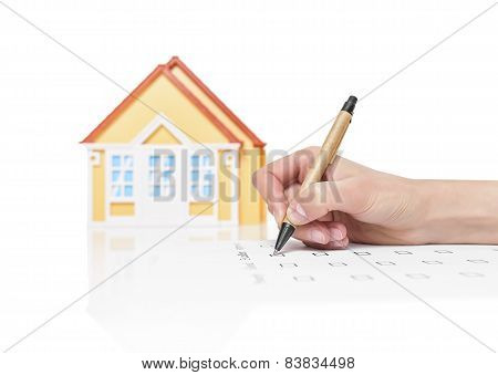 Female signing contract on a house