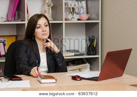 Thoughtful Girl In The Office Head Table Sits At Computer And Holds Hand Of Person