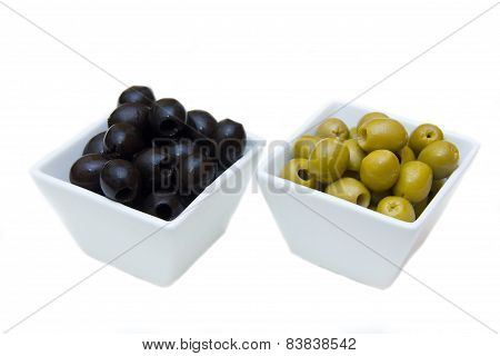 Bowls with green and black olives