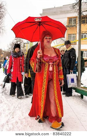 A Women In Red Prepares For Ice Swimming.