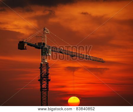 Construction Crane Hoisting The Sun