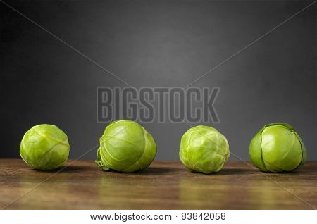 Four Brussels Sprouts On A Row