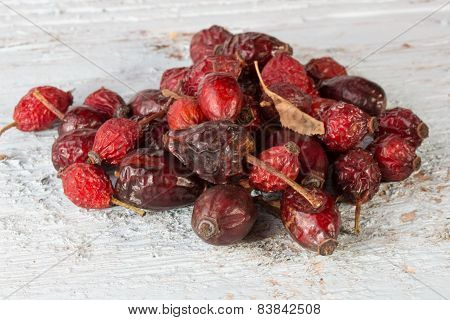 Dried Rose Hips Berries On A Wooden Background