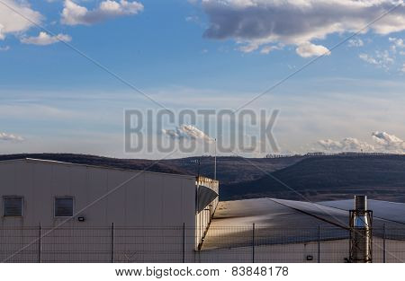 Factory Roofs Against The Nature Background