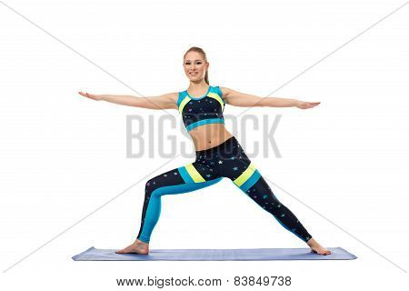 Pretty girl engaged in aerobics on mat