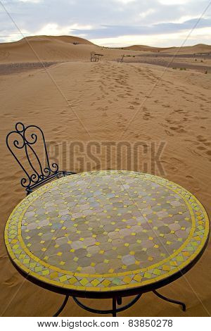 Table And Seat In Sand