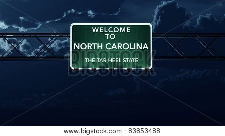 North Carolina USA State Welcome to Interstate Highway Sign at Night