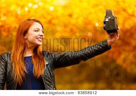 Woman Taking Photo Picture With Old Camera Outdoor