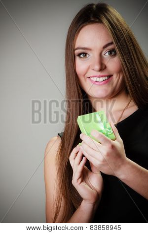 Woman In Dress Holding Green Gift Box