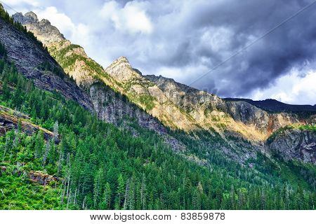 Storm Clouds Above The Mountains At The Avalanche Lake In Glacier National Park