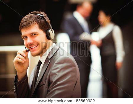 man working at callcenter using headset
