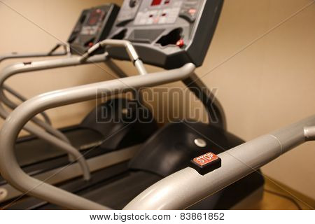 Room with gym equipment in the sport club, sport club gym , Health and recreation room