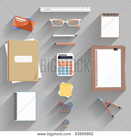 Calculator, ruler and paper on an office desk