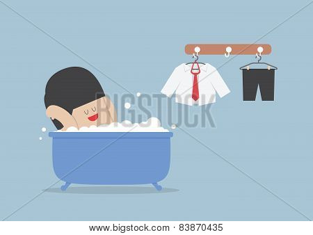 Businessman Taking A Bath And Relaxing In Bathtub