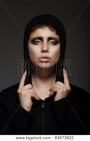 Trendy Young Woman In Hood Over Black Background