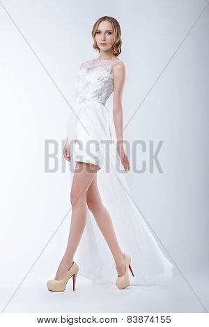 Slender Fashion Model Wearing White Dress