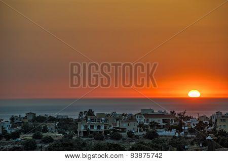 Sunset Over Village On Sea Coast