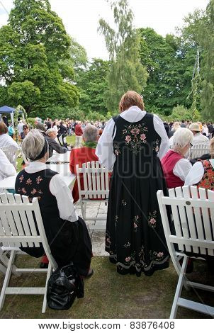 People at Midsummer celebrations and Norwegian - Swedish wedding