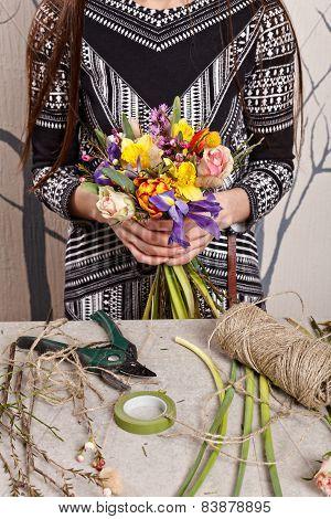 Hands Of Florist Making Bouquet Spring Flowers