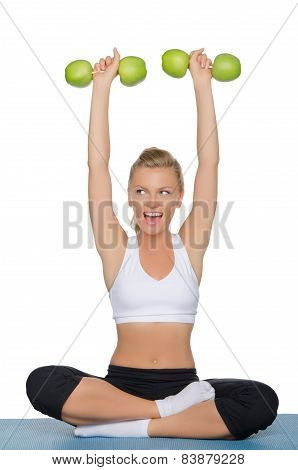Woman With Dumbbells Of Green Apples Looking Away