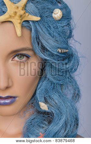 Portrait Of Woman With Blue Hair And Shells